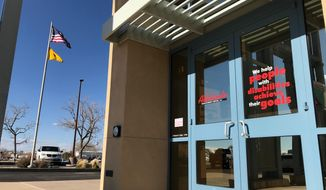 This March 18, 2019 image shows the entrance to the Adelante Development Center in Albuquerque, New Mexico. The state attorney general's office announced Monday that it was investigating allegations that the nonprofit organization, which helps people with developmental disabilities find jobs, was underpaying workers. The organization said it welcomes the attorney general's review of labor laws that govern pay for workers within the disability community. (AP Photo/Susan Montoya Bryan)