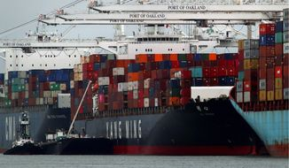 The Yang Ming shipping line container ship Ym Utmost is unloaded at the Port of Oakland on Monday, July 2, 2018, in Oakland, Calif. The Trump administration on Friday, July 6, 2018, will start imposing tariffs on $34 billion in Chinese imports. (AP Photo/Ben Margot)