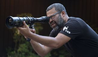 """This image released by Universal Pictures shows writer, producer and director Jordan Peele on the set of his film, """"Us."""" (Claudette Barius/Universal Pictures via AP)"""