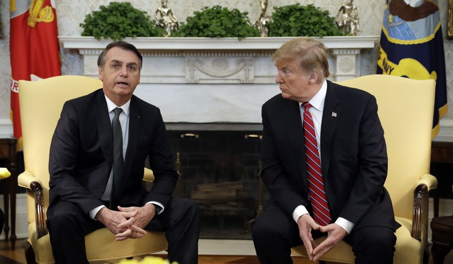 President Donald Trump meets with Brazilian President Jair Bolsonaro in the Oval Office of the White House, Tuesday, March 19, 2019, in Washington. (AP Photo/Evan Vucci)