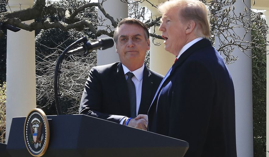 President Donald Trump and visiting Brazilian President Jair Bolsonaro shake hands as they conclude a news conference on the Rose Garden of the White House, Tuesday, March 19, 2019, in Washington. (AP Photo/Manuel Balce Ceneta)