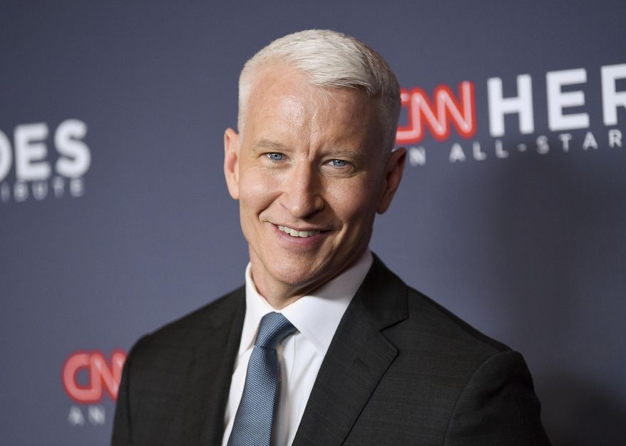 """FILE - In this Dec. 9, 2018 file photo, host Anderson Cooper attends the 12th annual CNN Heroes: An All-Star Tribute at the American Museum of Natural History, in New York. Cooper has a 2-book deal and plans for collaborating with historian-novelist Katherine Howe. Harper announced Tuesday, March 19, 2019, that the CNN anchor and """"60 Minutes"""" correspondent will work on two books of nonfiction with Howe, who specializes in novels about witchcraft, including """"The Daughters of Temperance Hobbs"""" and """"The Physick Book of Deliverance Dane."""" (Photo by Evan Agostini/Invision/AP, File)"""
