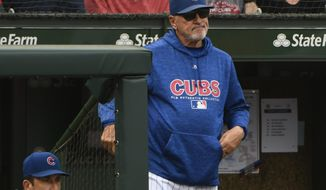 FILE - In this Oct. 1, 2018, file photo, Chicago Cubs manager Joe Maddon (70) looks on after Milwaukee Brewers' Domingo Santana (16) scores during the eighth inning of a tie break baseball game against the Chicago Cubs in Chicago. After four consecutive playoff appearances and the 2016 World Series title, the Chicago Cubs are way past playing for Maddon's future. Maddon is entering the final year of his contract after the team declined to offer an extension to its 65-year-old manager. (AP Photo/Matt Marton, File)