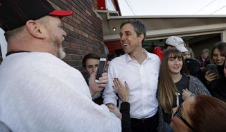 Democratic presidential candidate Beto O'Rourke greets supporters after speaking at Gino's Cento Anno, Monday, March 18, 2019, in Cleveland. (AP Photo/Tony Dejak)