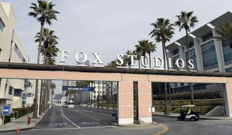 The exterior of Fox Studios is pictured, Tuesday, March 19, 2019, in Los Angeles. Disney's $71.3 billion acquisition of Fox's entertainment assets is set to close around 12 a.m. EDT on Wednesday. (AP Photo/Chris Pizzello)