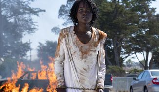 """This image released by Universal Pictures shows Lupita Nyong'o in a scene from """"Us,"""" written, produced and directed by Jordan Peele. (Claudette Barius/Universal Pictures via AP)"""