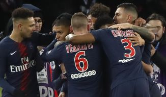 Teammates congratulate PSG's Kylian Mbappe, second left, after he scored his side's first goal during their French League One soccer match between Paris-Saint-Germain and Olympique Marseille at the Parc des Princes stadium in Paris, Sunday, March 17, 2019. (AP Photo/Christophe Ena)