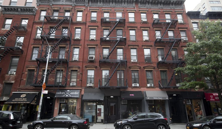 FILE - This Aug. 31, 2018 file photo shows Kushner family real estate firm-owned buildings 333, center, and 335 East 9th Street in the East Village neighborhood of New York. On Tuesday, March 19, 2019, a New York City councilman accused the company of putting tenants in danger by allowing several of its building to avoid safety inspections. (AP Photo/Mary Altaffer, File)