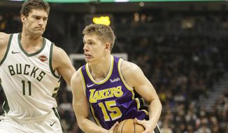 Los Angeles Lakers' Moritz Wagner(15) drives against the Milwaukee Bucks' Brook Lopez during the first half of an NBA basketball game Tuesday, March 19, 2019, in Milwaukee. (AP Photo/Jeffrey Phelps)