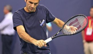 Roger Federer, of Switzerland, practices for the Miami Open tennis tournament in Miami Gardens, Fla., Monday, March 18, 2019. (Charles Trainor Jr./Miami Herald via AP)