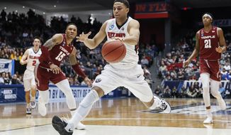 Belmont's Kevin McClain drives to the net during the first half of a First Four game of the NCAA college basketball tournament against Temple, Tuesday, March 19, 2019, in Dayton, Ohio. (AP Photo/John Minchillo)