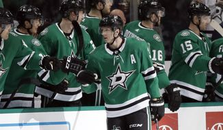 Dallas Stars defenseman John Klingberg (3) is congratulated by the bench after scoring against the Florida Panthers in the second period of an NHL hockey game in Dallas, Tuesday, March 19, 2019. (AP Photo/Tony Gutierrez)