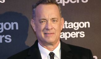 FILE - In this Jan. 13, 2018, file photo, Actor Tom Hanks poses for photographers on arrival at the French premiere of the film 'The Post' in Paris, France. Hanks recently surprised a New Mexico woman celebrating her birthday at an Albuquerque, N.M., restaurant by singing 'Happy Birthday' to her. (AP Photo/Michel Euler,File)