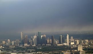 A plume of smoke from a petrochemical fire at the Intercontinental Terminals Company is shown over downtown Houston Monday, March 18, 2019. The large fire at the Houston-area petrochemicals terminal will likely burn for another two days, authorities said Monday, noting that air quality around the facility was testing within normal guidelines. (AP Photo/David J. Phillip)