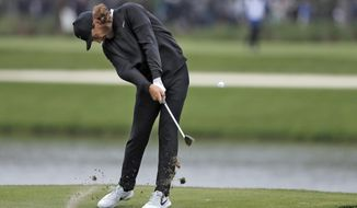 Tommy Fleetwood, of England, hits from the sixth fairway during the final round of The Players Championship golf tournament Sunday, March 17, 2019, in Ponte Vedra Beach, Fla. (AP Photo/Gerald Herbert)