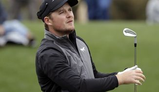 Eddie Pepperell, of England, watches the flight of his tee shot on the third hole during the final round of The Players Championship golf tournament Sunday, March 17, 2019, in Ponte Vedra Beach, Fla. (AP Photo/Lynne Sladky)