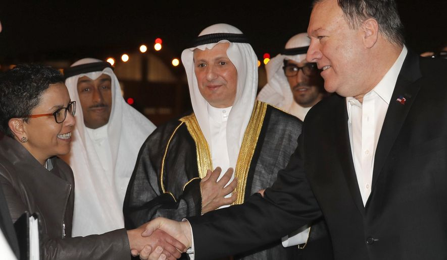 U.S. Secretary of State Mike Pompeo shakes hands with Ambassador Reem Al-Khaled, as he arrives at Kuwait International Airport in Kuwait City, Kuwait, Tuesday, March 19, 2019. (Jim Young/Pool Image via AP)