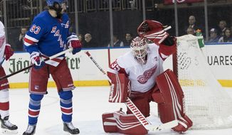 Detroit Red Wings goaltender Jimmy Howard (35) makes the save against New York Rangers center Mika Zibanejad (93) during the second period of an NHL hockey game, Tuesday, March 19, 2019, at Madison Square Garden in New York. (AP Photo/Mary Altaffer)