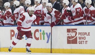 Detroit Red Wings center Andreas Athanasiou (72) celebrates after scoring a goal during the second period of an NHL hockey game against the New York Rangers, Tuesday, March 19, 2019, at Madison Square Garden in New York. (AP Photo/Mary Altaffer)