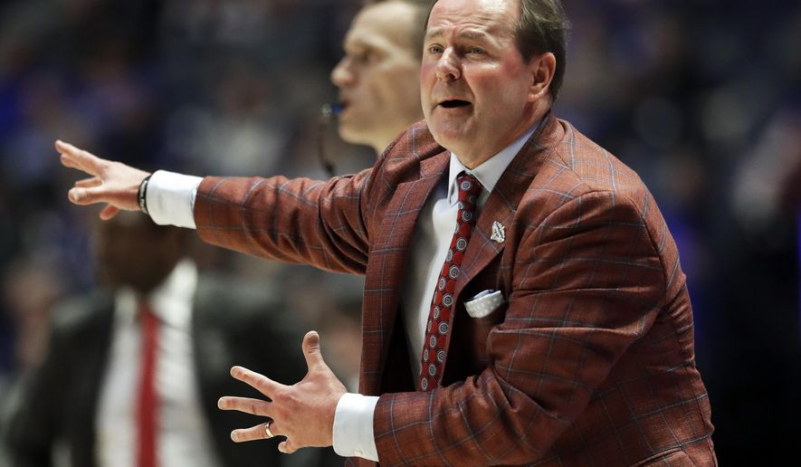 Mississippi head coach Kermit Davis yells to his players in the second half of an NCAA college basketball game against Alabama at the Southeastern Conference tournament Thursday, March 14, 2019, in Nashville, Tenn. Alabama won 62-57. (AP Photo/Mark Humphrey)