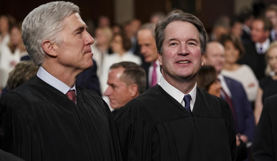 Supreme Court Associate Justices Neil Gorsuch, left, and Brett Kavanaugh watch as President Donald Trump arrives to give his State of the Union address to a joint session of Congress at the Capitol in Washington. (Doug Mills/The New York Times via AP, Pool) ** FILE **