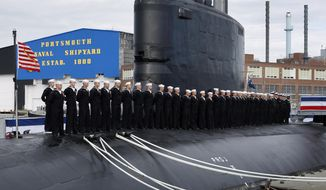 In this Oct. 25, 2008, file photo, sailors line the deck during the commissioning of the USS New Hampshire, a Virginia-class nuclear submarine, at the Portsmouth Naval Shipyard, in Kittery, Maine. On July 11, 2019, a group of Republican lawmakers from mostly western states urged President Trump to impose quotas on uranium imported from Russia and elsewhere as a matter of national security, saying the U.S. has become too dependent on adversaries for the fuel that powers everything from the electric grid to nuclear submarines. (AP Photo/Robert F. Bukaty, files)