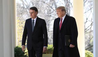 President Donald Trump walks with visiting Brazilian President Jair Bolsonaro along the Colonnade of the White House, Tuesday, March 19, 2019, in Washington. (AP Photo/Manuel Balce Ceneta) ** FILE **