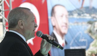 Turkey's President Recep Tayyip Erdogan addresses the supporters of his ruling Justice and Development Party during a rally in Eregli, Turkey, Tuesday, March 19, 2019. Ignoring widespread criticism, Erdogan has again shown excerpts of a video taken by the attacker who killed 50 people in mosques in New Zealand at a campaign rally. (Presidential Press Service via AP, Pool)