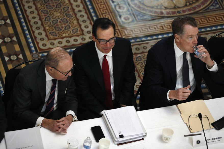 In this Feb. 21, 2019, file photo White House economic adviser Larry Kudlow, left, Treasury Secretary Steve Mnuchin, and U.S. Trade Representative Robert Lighthizer, attend a meeting of senior U.S. and Chinese officials to resume trade negotiations in Washington.  Top U.S. trade and economic officials will visit China late next week for another round of negotiations, a White House official says. Mnuchin and Lighthizer will lead the delegation, Trump administration officials say. (AP Photo/Jacquelyn Martin, File) **FILE**
