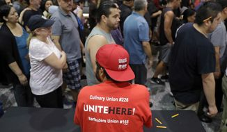 FILE - In this May 22, 2018 file photo, Culinary Union members exit a university arena after voting on whether to authorize a strike in Las Vegas. Hospitality workers around the country will picket the restaurants of celebrity chefs and offices other business partners of a Las Vegas-based casino operator that has refused to bargain with a union. The Culinary Union on Tuesday. March 19, 2019 said the picketing workers in San Francisco, Cleveland and other cities will demand that Station Casinos begin contract negotiations with employees of the Palms casino-resort. (AP Photo/Isaac Brekken, File)