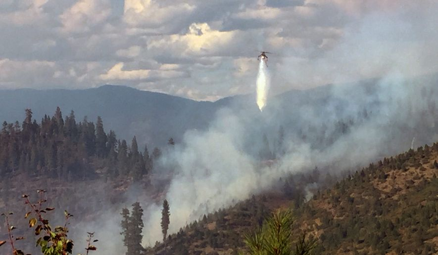 Though the residents of Idaho have long been wary, if not disdainful, of climate change science, the prolonged wildfire smoke has prompted Republicans in the Legislature to reconsider the issue. (Associated Press)