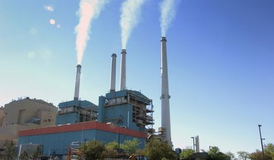 In this July 1, 2013, file photo, smoke rises from the Colstrip Steam Electric Station, a coal-burning power plant in Colstrip, Mont. (AP Photo/Matthew Brown, File)