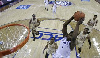 Duke's Zion Williamson (1) goes up to dunk against Florida State during the first half of the NCAA college basketball championship game of the Atlantic Coast Conference tournament in Charlotte, N.C., Saturday, March 16, 2019. (AP Photo/Chuck Burton) **FILE**