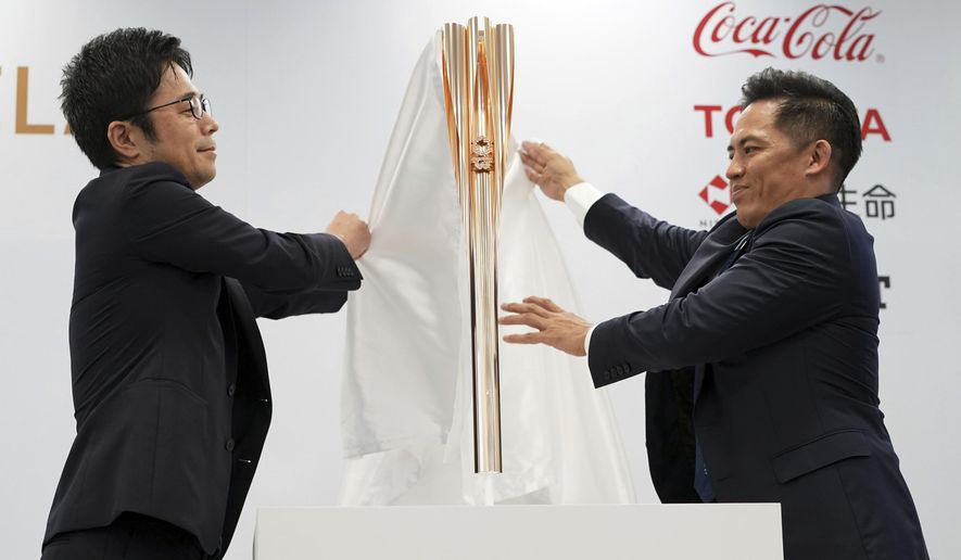 The Olympic torch of the Tokyo 2020 Olympic Games is unveiled during a press conference in Tokyo Wednesday, March 20, 2019. The torch is the centerpiece of attention in the months just before the Olympics open. The Tokyo Olympics open on July 24, 2020.(AP Photo/Eugene Hoshiko)