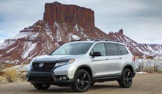 This undated photo provided by Honda shows the 2019 Honda Passport, one of the newest midsize SUVs available. Chevrolet and Honda make popular small and large crossover SUVs but have long lacked a choice in the middle. Interestingly, both companies decided to fill that gap this year with new models that revive nameplates of the past: the 2019 Chevrolet Blazer and the 2019 Honda Passport. (American Honda Motor Co. via AP)
