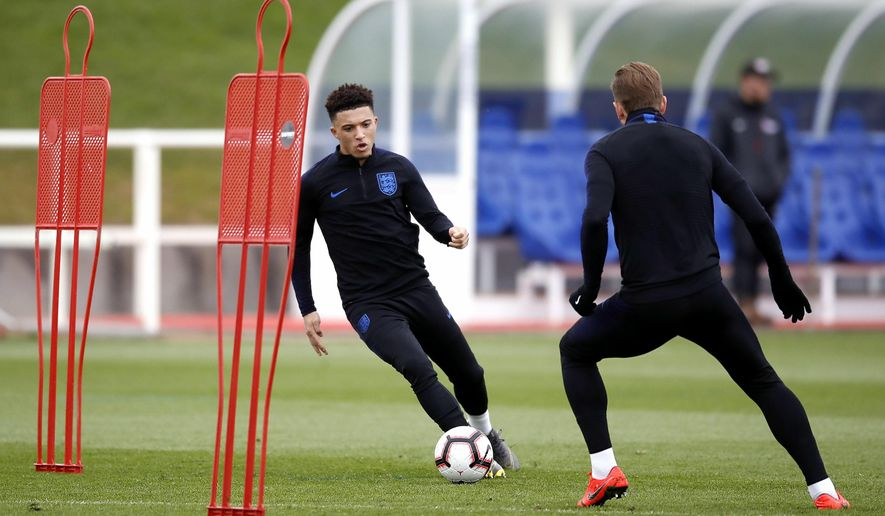 England's Jadon Sancho, left, during a training session for England soccer team at St George's Park in Burton, England, Tuesday March 19, 2019. England play the Czech Republic in a Euro qualifier match on upcoming Friday March 22.(Martin Rickett/PA via AP)