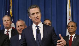 Gov. Gavin Newsom, center, discusses the homeless problem facing California after a meeting with the mayors of some of the state's largest cities held at the governor's office, Wednesday, March 20, 2019, in Sacramento, Calif. Newsom and the mayors are asking the legislature for more money on top of the $500 million the state has already given cities for programs assisting the homeless. Accompanying Newsom are California mayors from left, Kevin Falconer, of San Diego, Darrell Steinberg, of Sacramento, Eric Garcetti, of Los Angeles, and Harry Sidhu of Anaheim, right. (AP Photo/Rich Pedroncelli)
