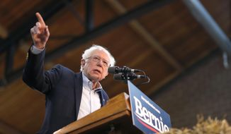 FILE - In this Saturday, March 9, 2019 file photo, 2020 Democratic presidential candidate Sen. Bernie Sanders speaks during a rally, at the Iowa state fairgrounds in Des Moines, Iowa. A union representing research and technical workers said it will strike Wednesday, March 20, at 10 University of California campuses and 5 hospitals in a one-day walkout after contract negotiations failed. The biggest rally is expected at the University of California, Los Angeles, where Sanders is scheduled to march and give a speech. (AP Photo/Matthew Putney, File)