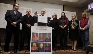Attorney Jeff Anderson speaks as attorney Marc Pearlman, left, and clergy abuse victims listen during a news conference, Wednesday, March 20, 2019, in Chicago. Advocates for clergy abuse victims say their list of 395 priests or lay people in Illinois who have been publicly accused of sexually abusing children is far more extensive than the names already released by the state's six dioceses. (AP Photo/Kiichiro Sato)