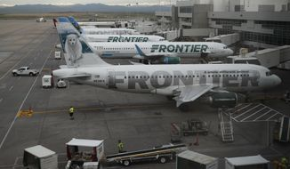 FILE - In this May 15, 2017 file photo, Frontier Airlines jetliners sit at gates at Denver International Airport. The union representing Frontier Airlines flight attendants says they have reached a tentative contract deal with the Denver-based budget carrier. The Association of Flight Attendants-CWA said both sides agreed to terms for the contract Tuesday, March 19, 2019,  but the language still needs to be finalized and approved by the flight attendants' elected union leaders. The union says the deal includes significant pay increases, schedule flexibility, quality of life enhancements and other benefits.  (AP Photo/David Zalubowski, File)