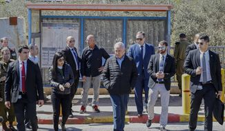 Israeli Prime Minister Benjamin Netanhayu, right, inspects the scene of a Sunday gun and knife attack, near the West Bank Israeli settlement of Ariel, Monday, March 18, 2019. Israel's military expanded its massive manhunt for a Palestinian assailant on Monday as authorities announced that a second Israeli died of wounds sustained in the West Bank attack. (Jack Guez/Pool via AP)
