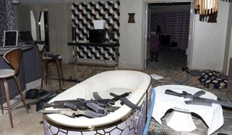 This October 2017 file evidence photo released by the Las Vegas Metropolitan Police Department Force Investigation Team Report shows the interior of Stephen Paddock's 32nd floor room of the Mandalay Bay hotel in Las Vegas after a mass shooting. Accounts of police collecting bullet fragments and tracing the shooter's gun purchases are among newly released records from the Oct. 2017 deadliest mass shooting in modern U.S. history. The more than 750 pages of documents distributed Wednesday, March 20, 2019, by Las Vegas police don't provide new information about a reason for the carnage that killed 58 people and injured more than 850. (Las Vegas Metropolitan Police Department via AP, File)