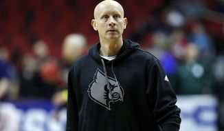Louisville head coach Chris Mack watches his team during practice at the NCAA men's college basketball tournament, Wednesday, March 20, 2019, in Des Moines, Iowa. Louisville plays Minnesota on Thursday. (AP Photo/Charlie Neibergall)