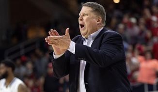 FILE - In this Saturday, March 16, 2019, file photo, Old Dominion coach Jeff Jones yells to his players during the second half of an NCAA college basketball game against Western Kentucky in the championship of the Conference USA tournament in Frisco, Texas. Old Dominion's battle to reach the NCAA Tournament came as its coach, Jeff Jones, was fighting cancer. (AP Photo/Jeffrey McWhorter, File)