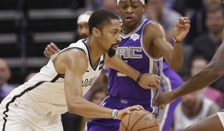 Brooklyn Nets guard Spencer Dinwiddie, left, drives against Sacramento Kings guard De'Aaron Fox, right, during the first quarter of an NBA basketball game Tuesday, March 19, 2019, in Sacramento, Calif. (AP Photo/Rich Pedroncelli)