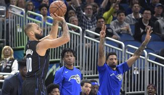 Orlando Magic guard Evan Fournier (10) goes up for a 3-pointer during the first half of the team's NBA basketball game against the New Orleans Pelicans on Wednesday, March 20, 2019, in Orlando, Fla. (AP Photo/Phelan M. Ebenhack)