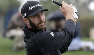 Dustin Johnson plays his shot from the third tee during the final round of The Players Championship golf tournament Sunday, March 17, 2019, in Ponte Vedra Beach, Fla. (AP Photo/Lynne Sladky)