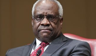 In this Feb. 15, 2018, file photo, Supreme Court Associate Justice Clarence Thomas sits as he is introduced during an event at the Library of Congress in Washington. (AP Photo/Pablo Martinez Monsivais, File) **FILE**