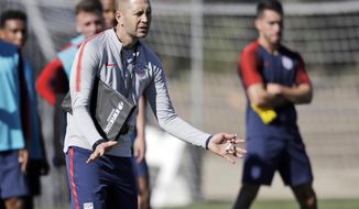 FILE - In this Jan. 7, 2019, file photo, United States head coach Gregg Berhalter instructs players during a soccer training camp in Chula Vista, Calif. Berhalter prepares for U.S. national team matches like a business executive getting ready for a deal, using video presentations when he meets with foreign-based players via computer. He has also tripled the team's data analysts to three. (AP Photo/Marcio Jose Sanchez, File)