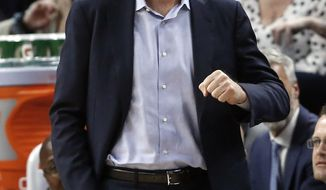 Golden State Warriors head coach Steve Kerr directs his team against the Minnesota Timberwolves in the second half of an NBA basketball game Tuesday, March 19, 2019, in Minneapolis. The Warriors won 117-107. (AP Photo/Jim Mone)